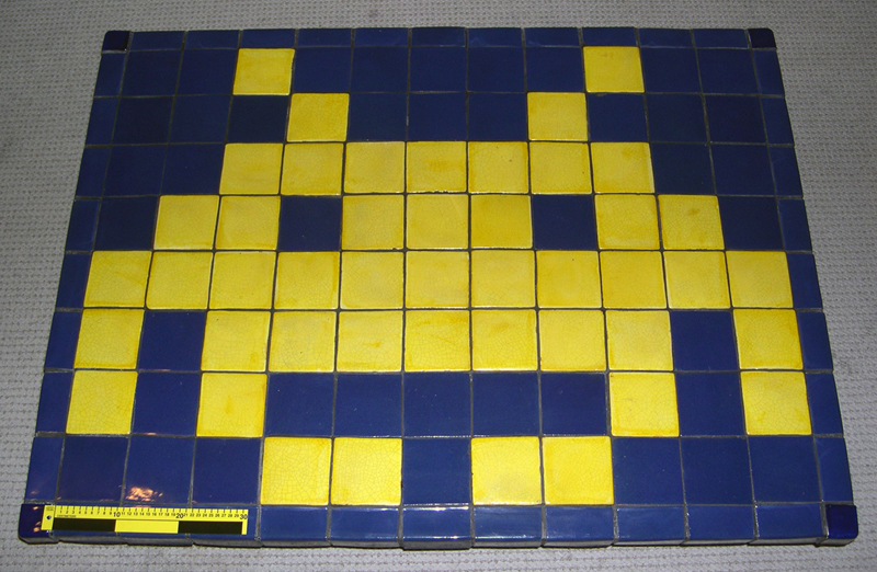 Table surface, with scale, showing tiling pattern.