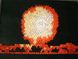 A nuclear explosion lovingly rendered in lite brite at approximately 8 ft. viewing distance.